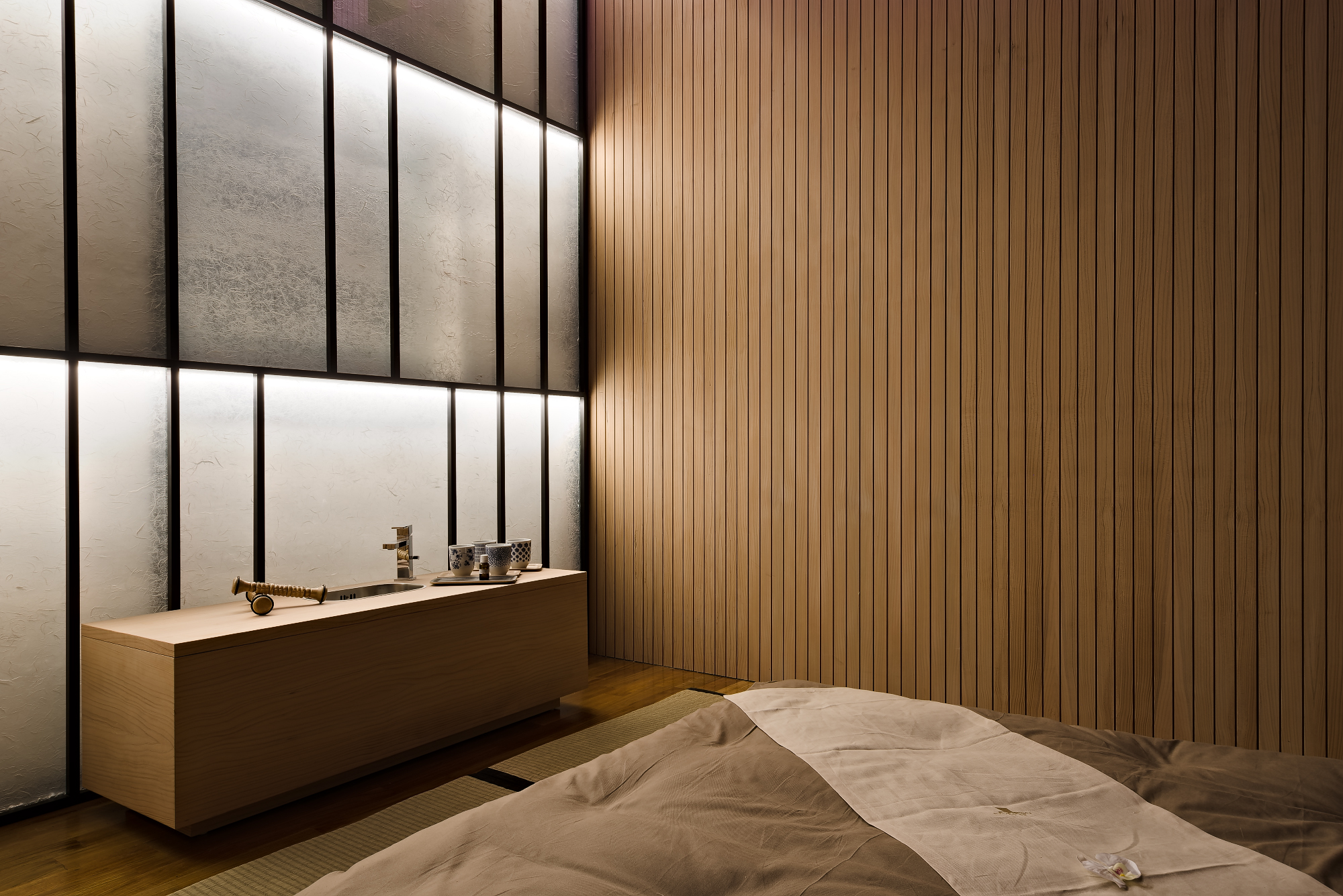 Longlife health spa Ayurveda room with the cedar wood walls and backlit rice paper panel. Washbasin unit in cedar wood with tatami on the floor